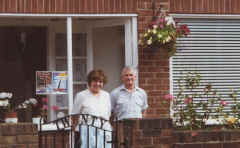 Mary and Bob outside their Bed & Breakfast.